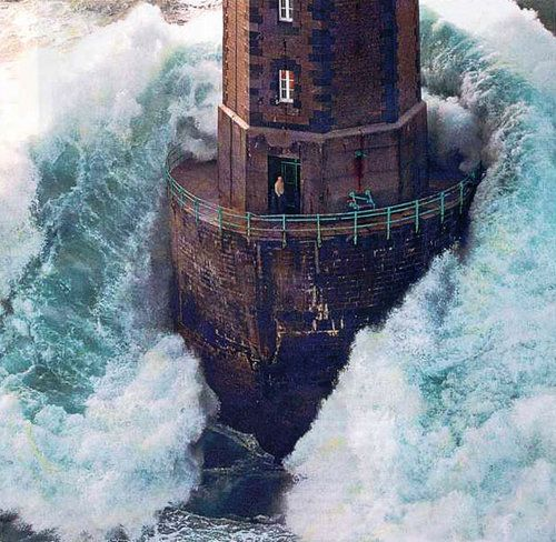 """Lighthouse living - (Lighthouse """"The Mare"""" in a storm. In Ar Gazec, Brittany, France. Photo by Jean Guichard, c. Dec. 1989 - www.jean-guichard.com)"""