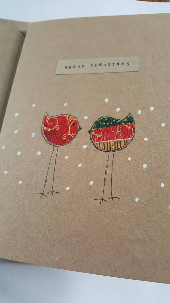 A handmade hand drawn card perfect for a friend at Christmas Holiday time. It depicts 2 stick robins in the snow using a combination of seasonal fabric and white paint. All cards packaged in protective cello wrapper.