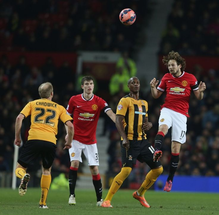 Daley Blind of Manchester United in action with Tom Elliott of Cambridge United during the FA Cup Fourth Round replay between Manchester United and Cambridge United