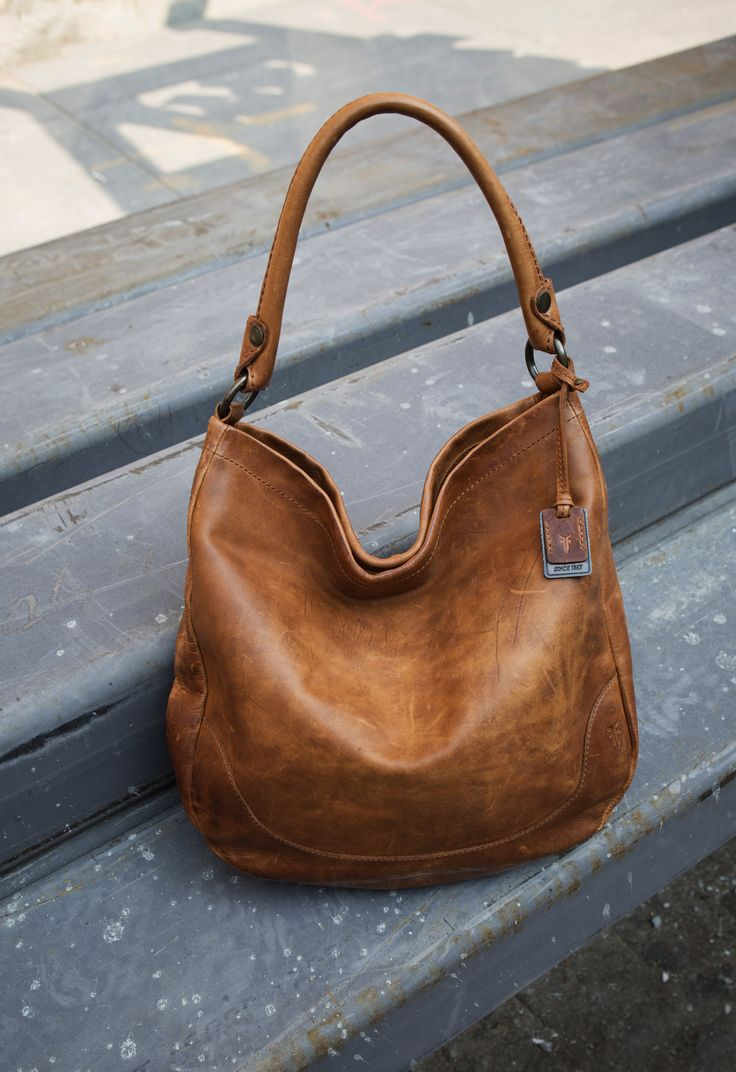 Designed with style and storage in mind, this beautifully colored classic Frye handbag is easy to carry (and hard to let go of!)