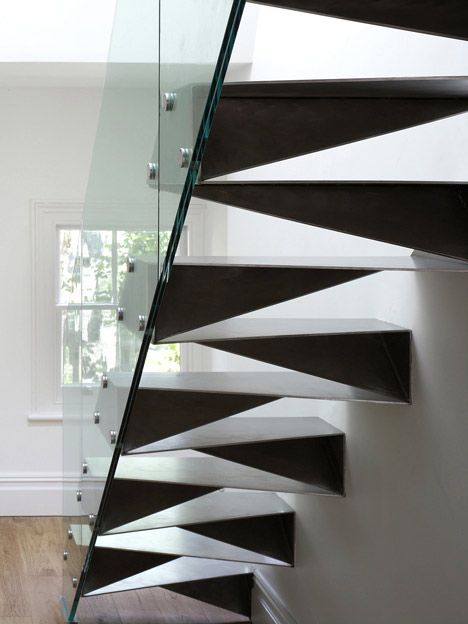 Origami Stair by Bell Phillips is made of folded 6mm stainless steel and framed with a glass balustrade.
