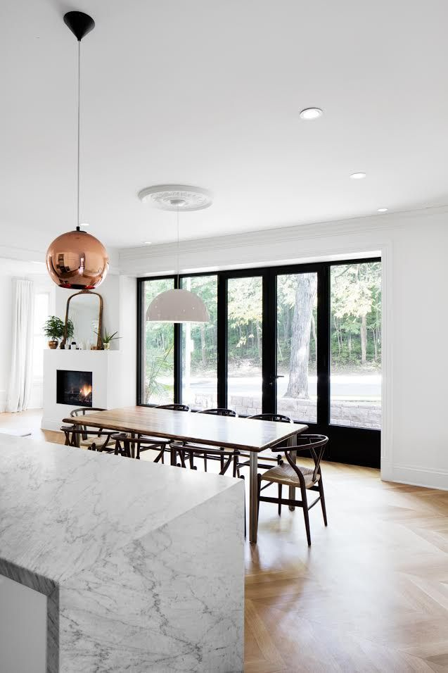 Dining room with Tom Dixon lighting.