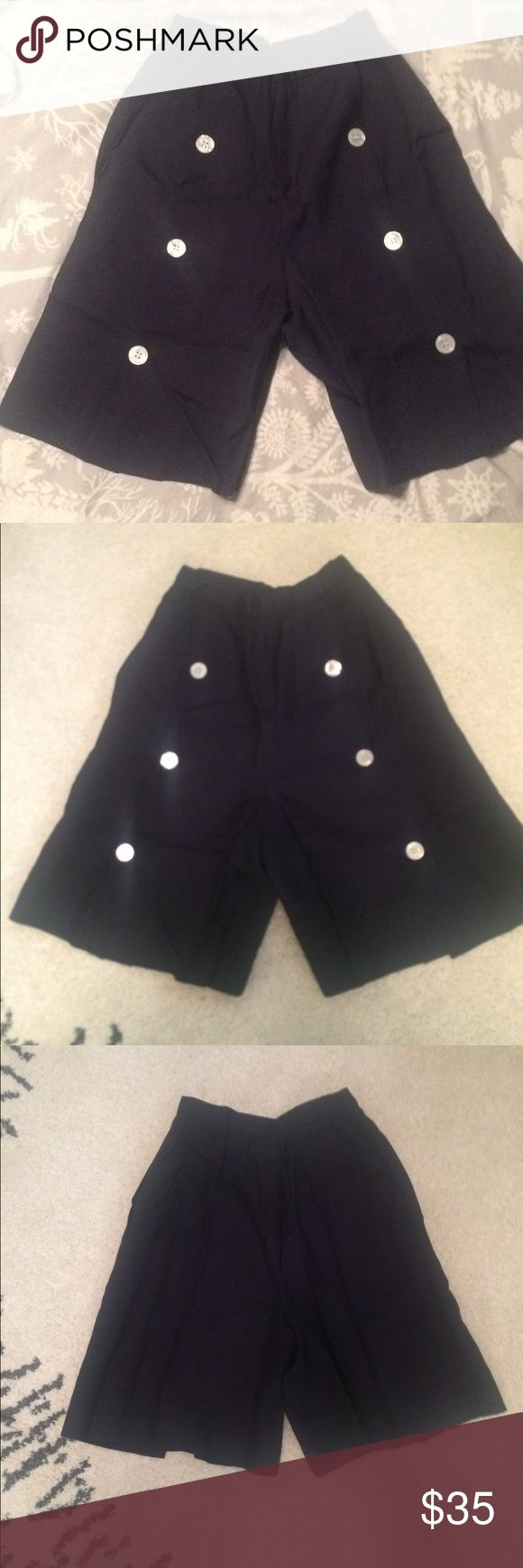 """⛵️ Vintage 80's  High Waisted Linen Shorts⛵️ Rare Early 80s Sailor Style Culottes/Walking Short.  Navy blue linen.  Original 1"""" Faux Mother of pearl buttons down front of each leg. Fully lined.  Side seam pockets.  1"""" banded, gathered Waist with 2 slide hook fasteners.  Wide leg, looks like a skirt when worn. Waist measures 12"""" across.  Rise 13"""". Inseam 8""""  Great Condition, No Flaws. Vintage Shorts"""