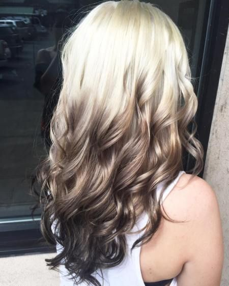 You can achieve this reverse ombré by using extensions on blonde hair