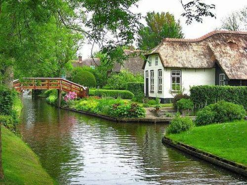 Geithoorn, Holland.  Most of the bridges are wooden and how folks get around.