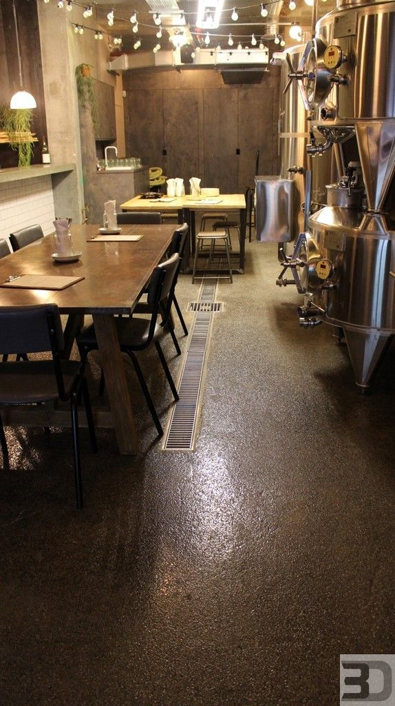 Clear Epoxy Coating - highly recommended for wet surfaces like commercial kitchens or wineries. The transparent coat allows you to see the concrete substrate providing an amazing industrial style interior. Floor installed for Vagabond Wines in Battersea London #epoxy #coating #flooring #industrialtrend #industrialdesign #restaurant #vagabondwines #winery #bar #resin #decor #commercial #floor