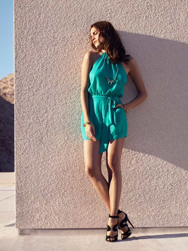 All eyes will be on you when you strut down the street in this must-have green romper.