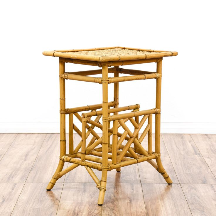 This tropical side table is featured in a bamboo with a glossy light wood finish. This end table has a woven wicker table top, latticework accents and a bottom magazine rack. Unique bohemian table perfect for a covered porch or patio! #bohemian #tables #endtable #sandiegovintage #vintagefurniture