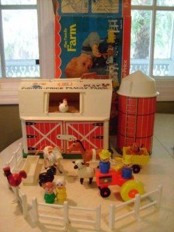 Fisher Price barnyard set. When you opened the barn door, you would hear a mooing sound. Very cutting-edge for the '70s. :)