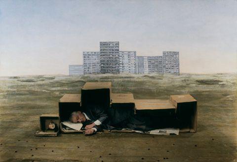 Man sleeping in box