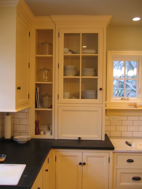 Vintage look kitchen with cream cabinets subway tile for Black and cream kitchen cabinets