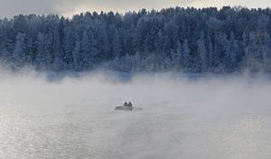 Two men row a boat through a frosty fog along the Yenisei River in temperatures of -20ºc near the Siberian city of Krasnoyarsk, Russia
