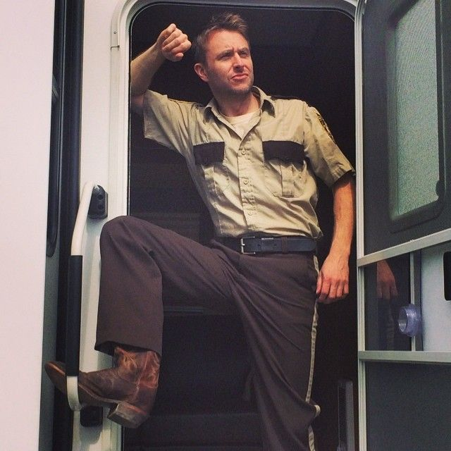 THE TALKING DEAD'S CHRIS HARDWICK ATTEMPTING A RICK GRIMES POSE ~ IN ANDREW LINCOLN'S WARDROBE PIECES ...  INCLUDING HIS BOOTS.