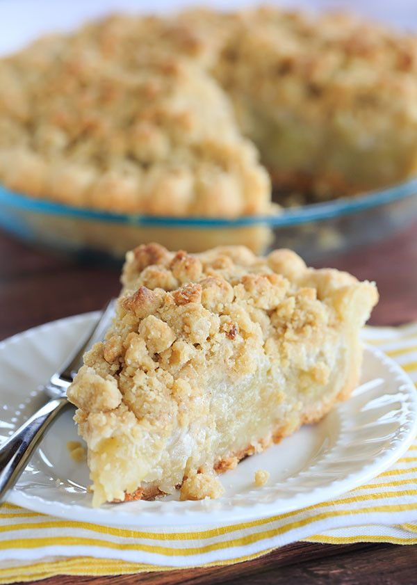 Dutch Apple Pie - A perfect crust piled high with the best apple filling and topped with a crunchy crumb. The perfect fall dessert!