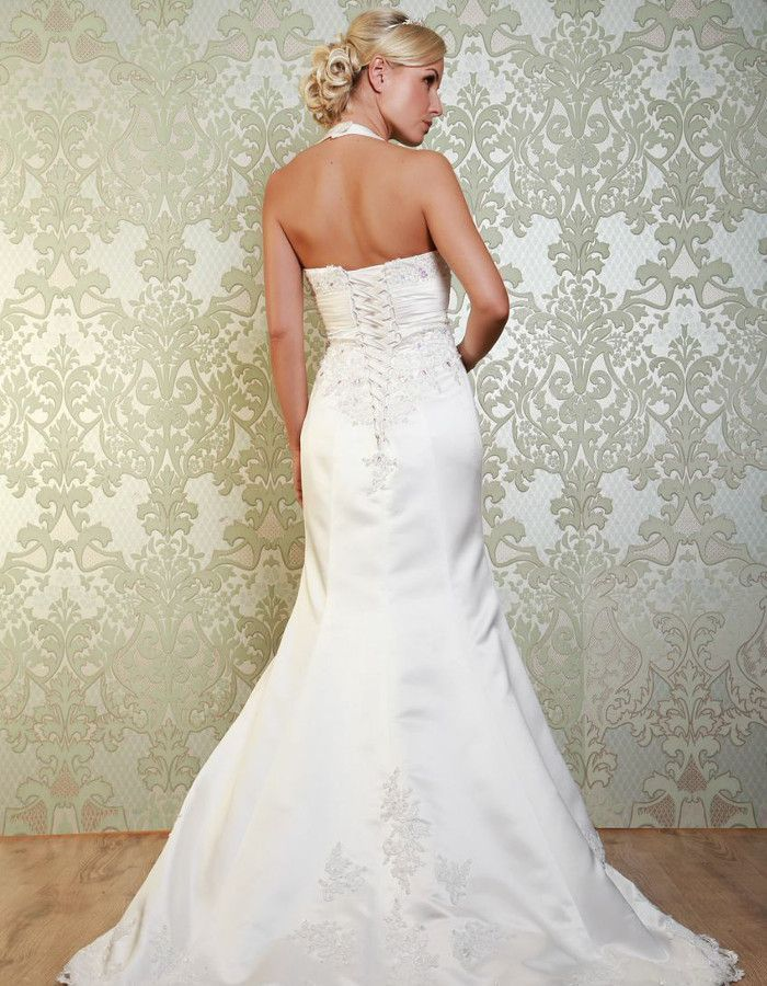 STANWYCK The ruched sash below the bust provides a flattering fit, completed by the lace up back above the skirts which flow into a gorgeous embroidered train. https://www.wed2b.co.uk/vintage-wedding-dresses/viva-bride-stanwyck.php