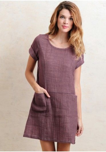 This chic dress features a gorgeous lavender hue with a subtle woven design in a soft linen and cotton blend. Perfected with a rounded neckline, shift silhouette, and cap sleeves, this darling dr...