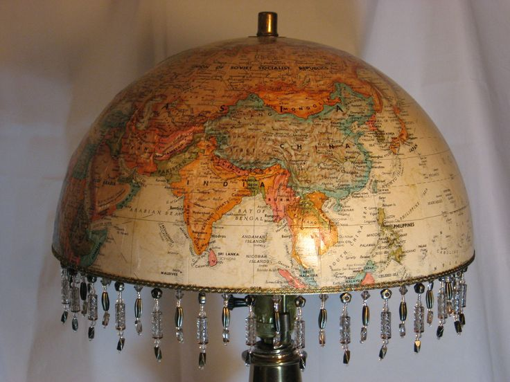 World Globe Lampshade,elegant, hand-crafted, vintage, (lamp NOT included) perfect for a living room, library, child's room, or travel theme. $65.00, via Etsy.