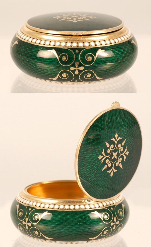 A Russian silver gilt and guilloche enamel box, Grachev Brothers, ST Petersburg, late 19th century. The circular box with bombe sides and hinged lid decorated in translucent emerald green enamel over a textured engine-turned ground with two bands of white enamel beads and gold scroll designs. 88 silver standard.
