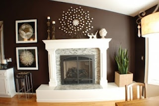 White Fireplace Mantle And Woodwork With Dark Brown Accent