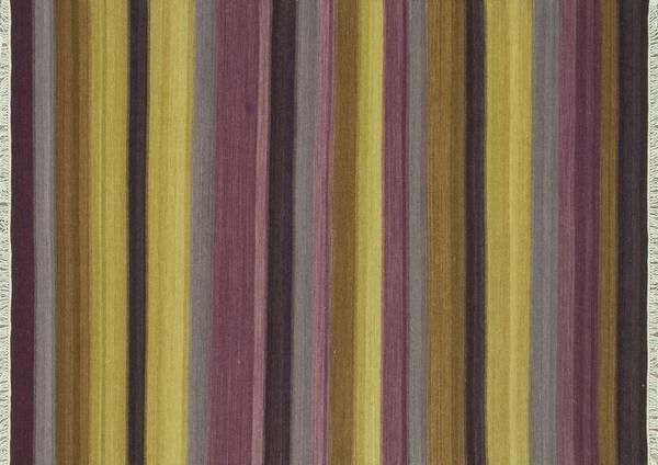 A modern twist on traditional kilims, this edgy new pattern is adorned with fun fringed ends. I Available at Rug & Home I #kilim #modern #purple #stripe