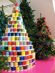 FREELANCE VISUAL MERCHANDISER | Find great visual display tips and examples like this colorful paint can tree on this blog. #windowdisplay #visualmerchandising
