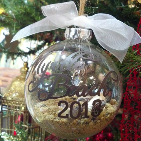Fill our glass ornaments with sand, shells, or other bits from a trip. Add a die-cut vinyl word cut with the Cameo to the outside (or stickers, or etch on the outside)!