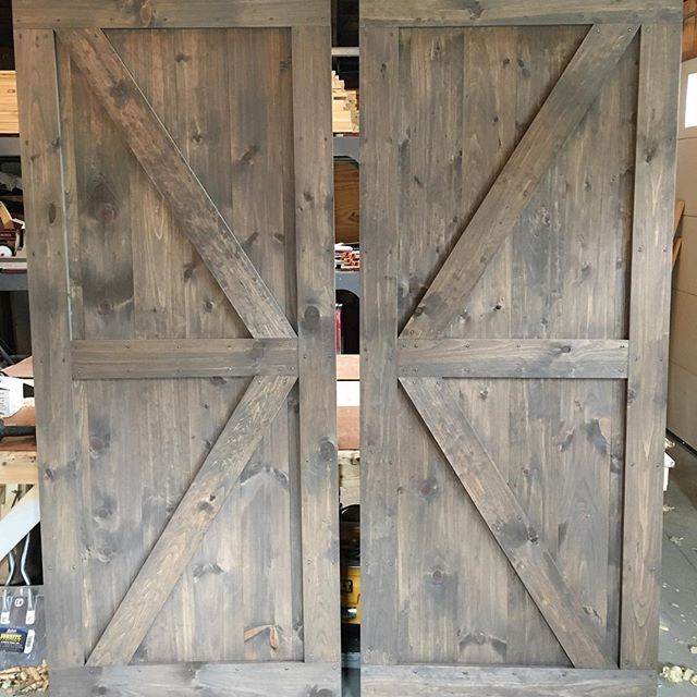 a pair of british brace barn doors with a mix of classic stain colors for pine cabinets stain colors for alder cabinets