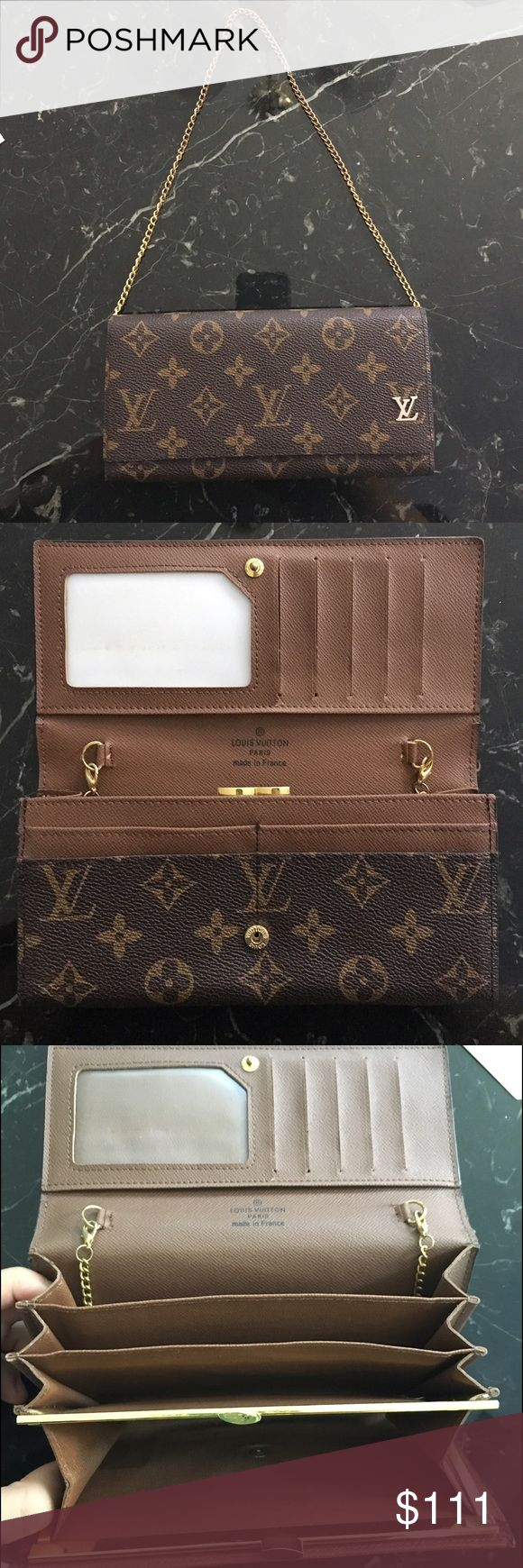Louis Vuitton wallet with handle I received this as a gift about 5-6 years ago, so auth is unknown. The metal is slightly worn and the edges are slightly chipped, but it's still in good condition!! Also, note how the ID holder has some slight discoloration to it. Please let me know if you have any questions!! Louis Vuitton Bags Wallets