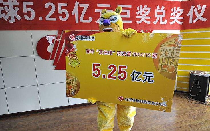 A lottery winner who scooped an enormous 520 million Yuan chose to wear a cartoon costume in order to remain anonymous when collecting his prize. China's charity fund lottery center said this is the third largest lottery sum in China's lottery history. Picture: HAP/Quirky China News/REX