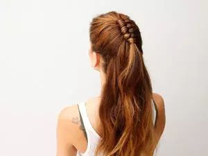 If the mini top-knot just isn't doing it for you like it used to, this chic half-up infinity braid is the way to go.