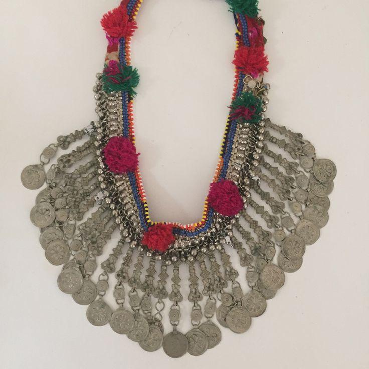 Pom Pom jingle jangle necklace.