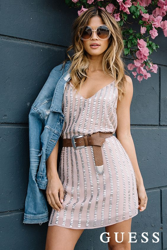The ultimate summer uniform. Dress down a sparkly shift dress with a classic denim jacket and leather belt. Click to shop LA babe Rocky Barnes' summer street style! #LoveGUESS