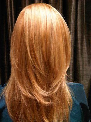 Strawberry blonde with soft blonde highlights.   Yelp