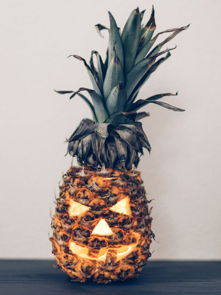 Fall Decorations, & Fall Decorating Ideas - PINEAPPLE JACK-O'-LANTERN - Because why not bring tropical spirit to a fall holiday? And while you're hacking away, test out your carving skills with an apple or some peppers, too. Get the full how-to at Redbookmag.com.