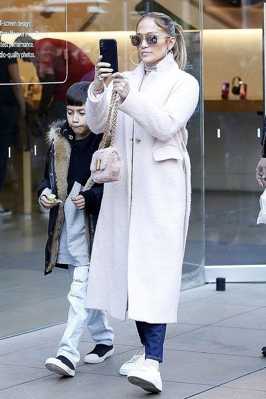 c617e0f5c68 Jennifer Lopez wears a Vince Coat and Anya Sneakers