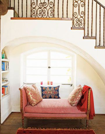 A red cashmere throw from J. Roaman hangs over a bench in the hallway of the designer's California home.