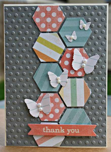 handmade card ... gray base embossed with dots ... column of punched hexagons ... luv the scattering of small white butterflies on the hexagons ...