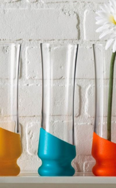 Dip some plain glass vases into colorful paint to add some serious color and fun to your living room! get more tips here http://www.rounakpaints.in/