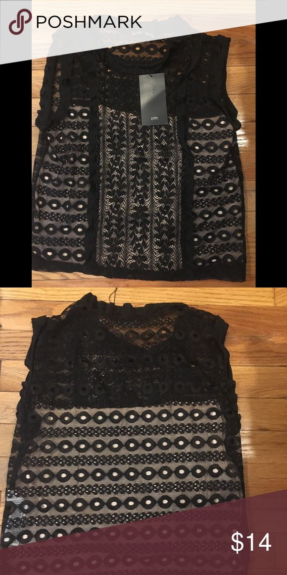 Ladies top Beautiful sleeveless  lace top , see through on the top half and lined on the bottom half. Great for the office with dress pants or even a night out. Zara Tops Blouses