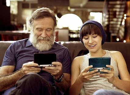 Robin Williams playing video games with his daughter Zelda...I really like this picture.