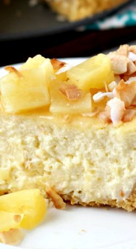 Piña Colada Cheesecake Recipe ~ A rich and creamy cheesecake filling infused with cream of coconut and pineapple chunks makes this piña colada cheesecake a pure delight that will transport you to the tropics in no time!