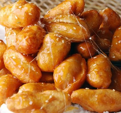 Korean Food Recipe: Mattang (Candies Sweet Potato).  Chunks of fried sweet potato in hot brown syrup.