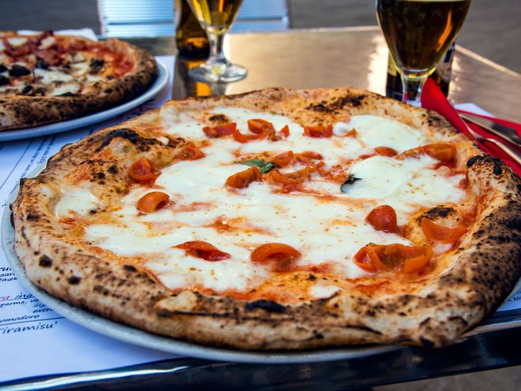 Italy's best pizzerias serve a variety of saucy, cheesy variations on the form, from thin-crust Neapolitan pies to deep-dish slices in Venice.