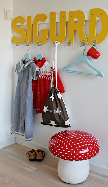 Love the idea of attaching a row of hooks to giant letters. Cute for a child's bedroom.