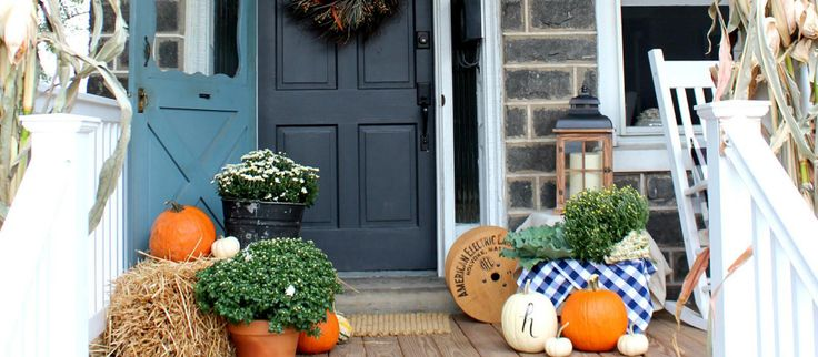 Add a harvest-inspired touch to your outdoor entryway with wreaths, textiles, and accents that capture the colors of the season. Traditional rocking chairs, mailboxes, and wall-mounted lighting add curb appeal that lasts year-round.