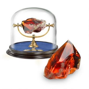 This Harry Potter Sorcerer's Stone is an authentic replica from the movie. Made of cut glass, red stone with glass dome measuring approximately 6-inches in height, this stone is a must have for every Harry Potter collector.