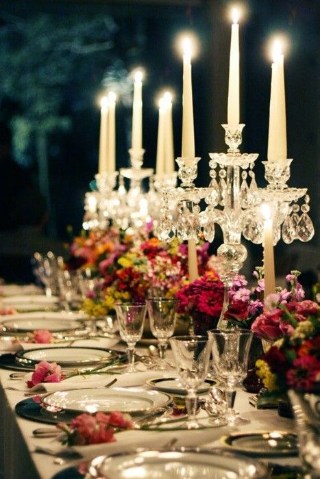 Candlelight Dining. Love the multiple high crystal candles & low flowers