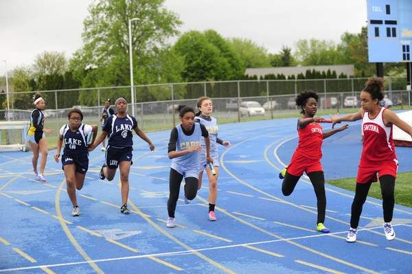 Timesha Cannon takes the baton from Rose Minni in the 100 relay. Click http://capegazette.villagesoup.com/p/beacon-track-girls-crush-cape-invitational-field-scoring-160-points/1520704 to read track article. Beacon track girls crush Cape Invitational field, scoring 160 points - By Dave Frederick