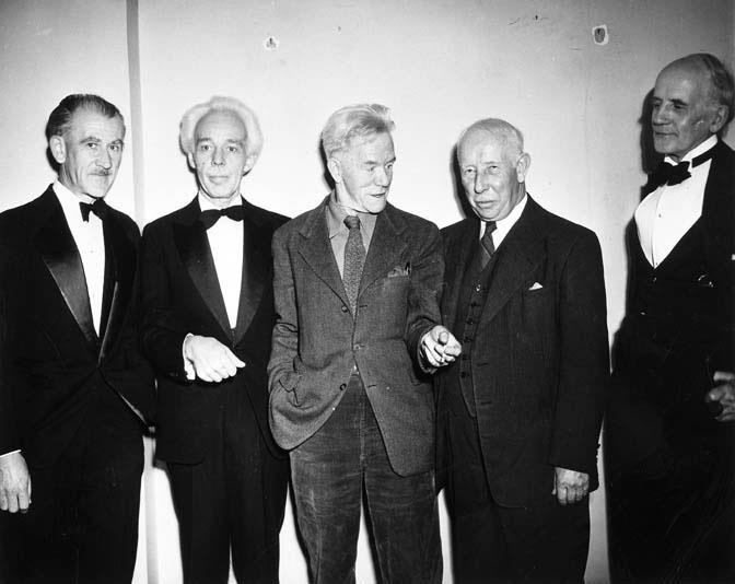 Group of Seven members A. J. Casson, Lawren Harris, F. H. Varley, A. Y. Jackson and Arthur Lismer attending the opening of the exhibition 'Lawren Harris, Paintings, 1910-1948' at the AGO.
