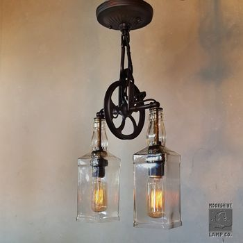 This is our newest fixture, The Carriage House Pendant.  We just love the old world feel of this dual pendant with recycled whiskey bottles.